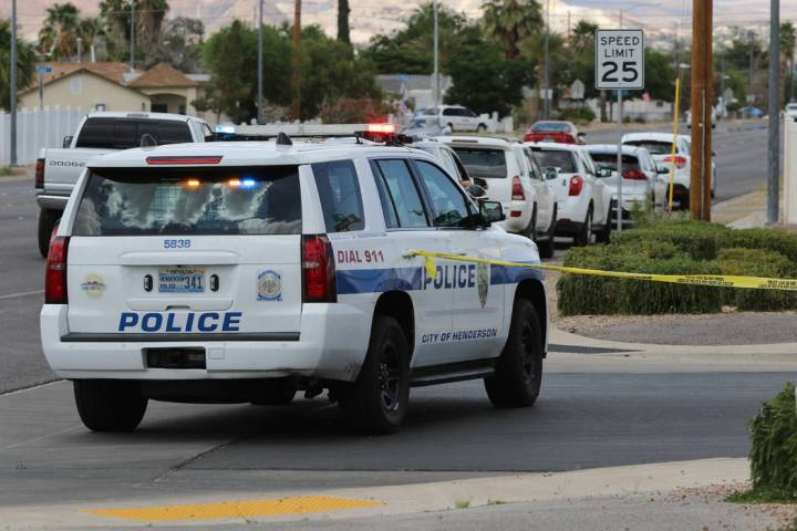 A police vehicle blocks the street near Van Wagenen Street and South Major Avenue, close to the ...