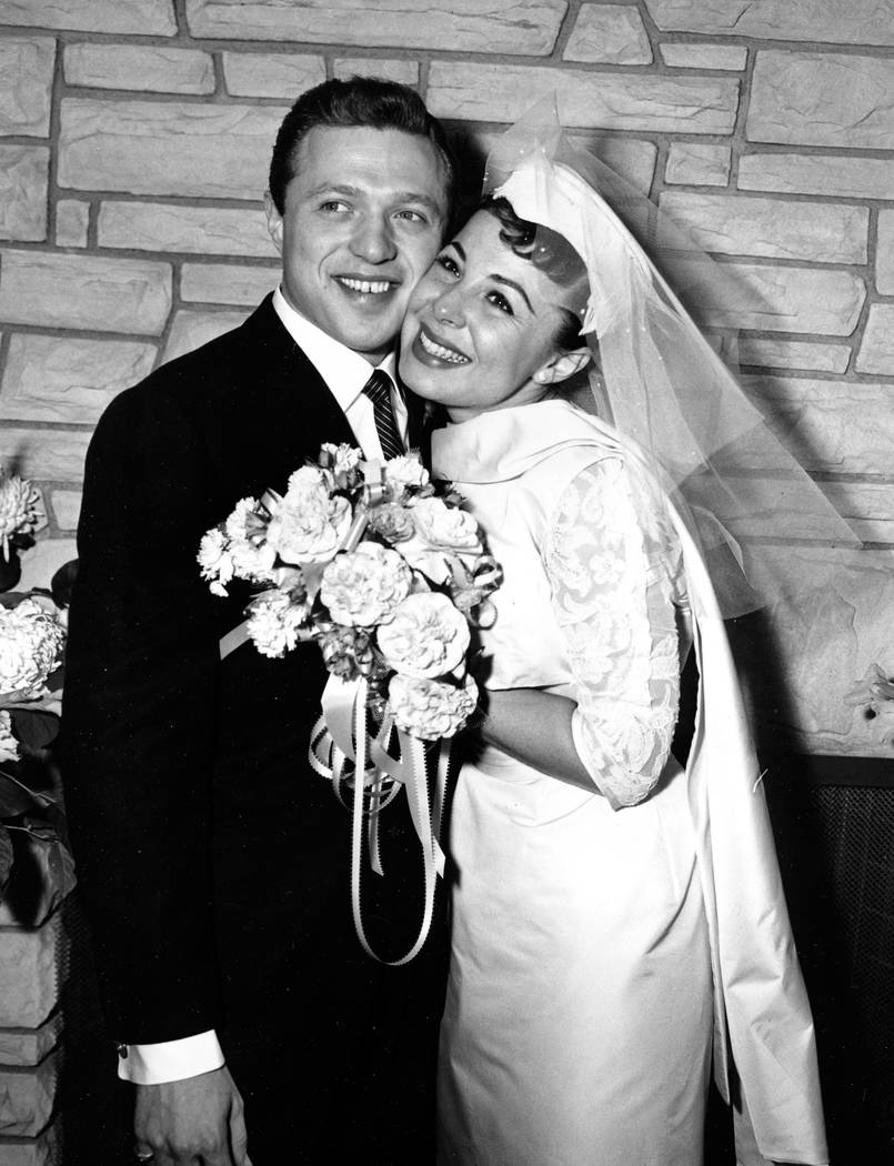 FILE - This Dec. 29, 1957 file photo, shows Eydie Gorme and Steve Lawrence, both 22, on their ...