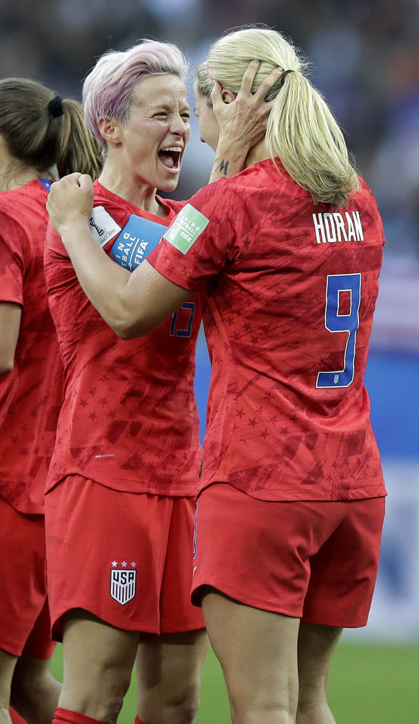 United States' scorer Lindsey Horan, right, and her teammate Megan Rapinoe, left, celebrate the ...