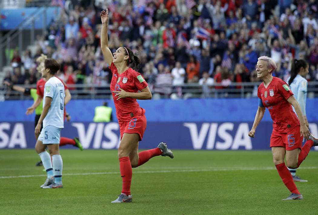 United States' Alex Morgan, left, celebrates after scoring the opening goal during the Women's ...