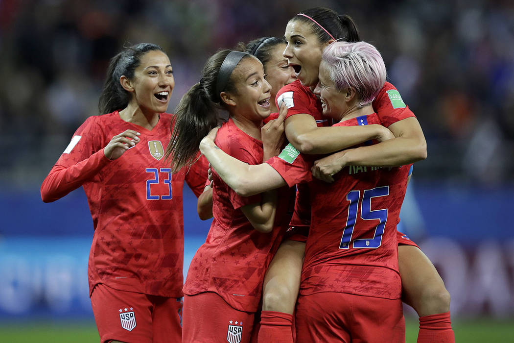 United States' Alex Morgan, second right, celebrates after scoring her side's 12th goal during ...