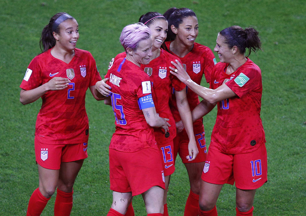 United States' Alex Morgan, centre, is congratulated by teammates after scoring her fifth goal ...