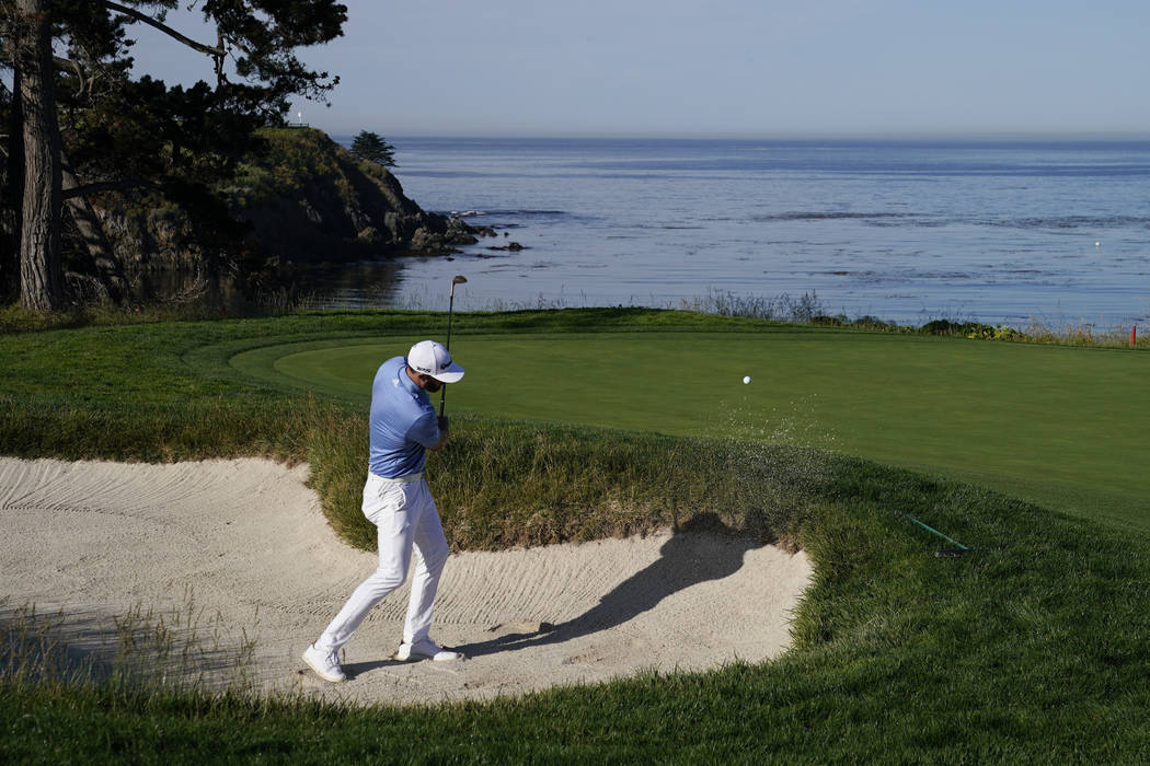 Dustin Johnson hits out of the bunker on the fifth hole during a practice round for the U.S. Op ...