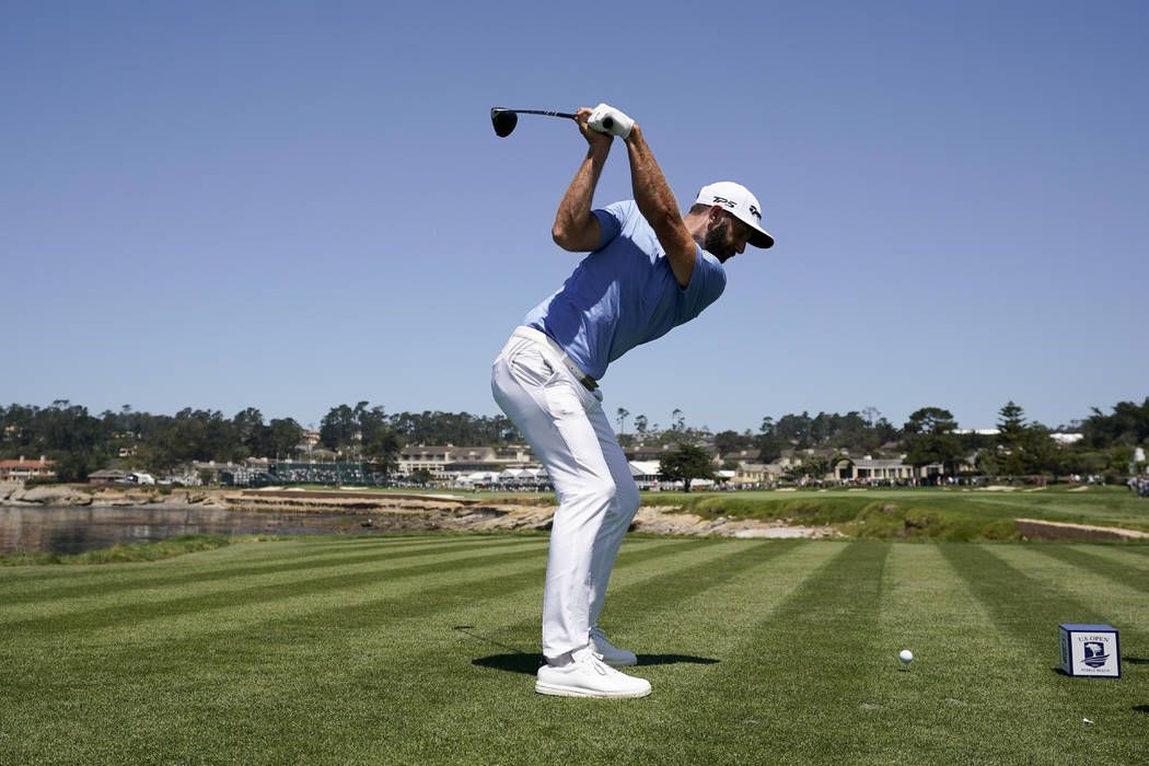 Dustin Johnson hits his tee shot on the 18th hole during a practice round for the U.S. Open Cha ...