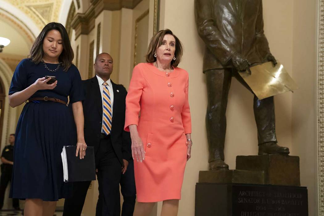 Speaker of the House Nancy Pelosi, D-Calif., walks to her office before voting on a resolution ...