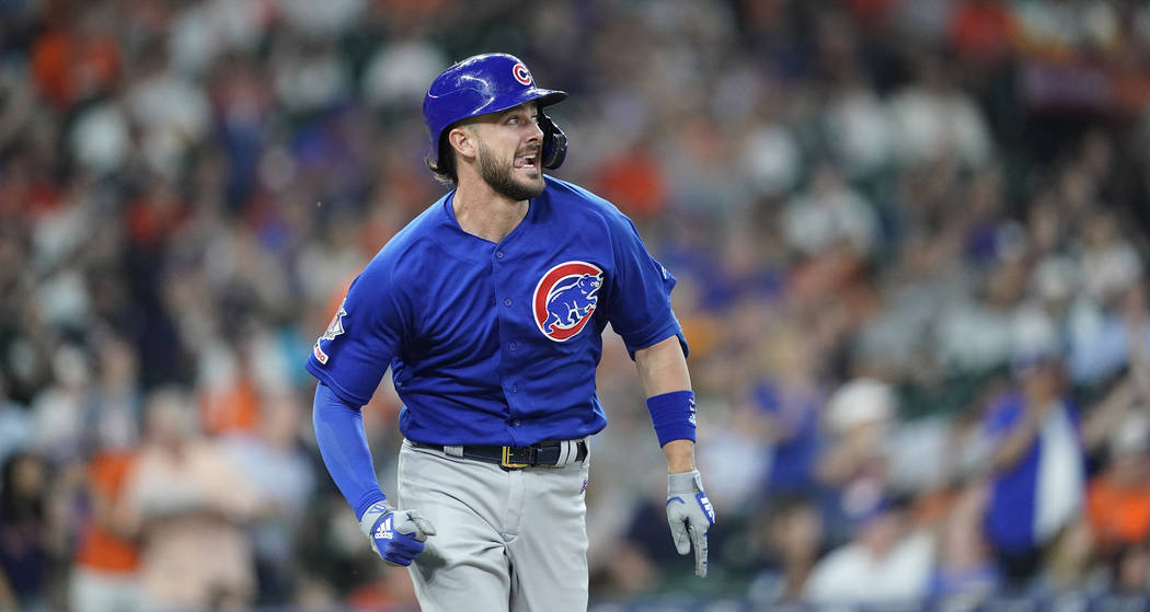 Chicago Cubs' Kris Bryant watches his home run against the Houston Astros during the third inni ...