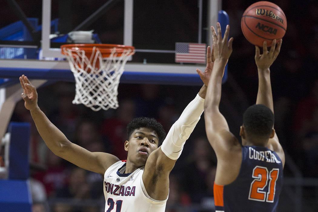 Utah State Aggies center Neemias Queta (23) raises a piece of a net after winning against San D ...