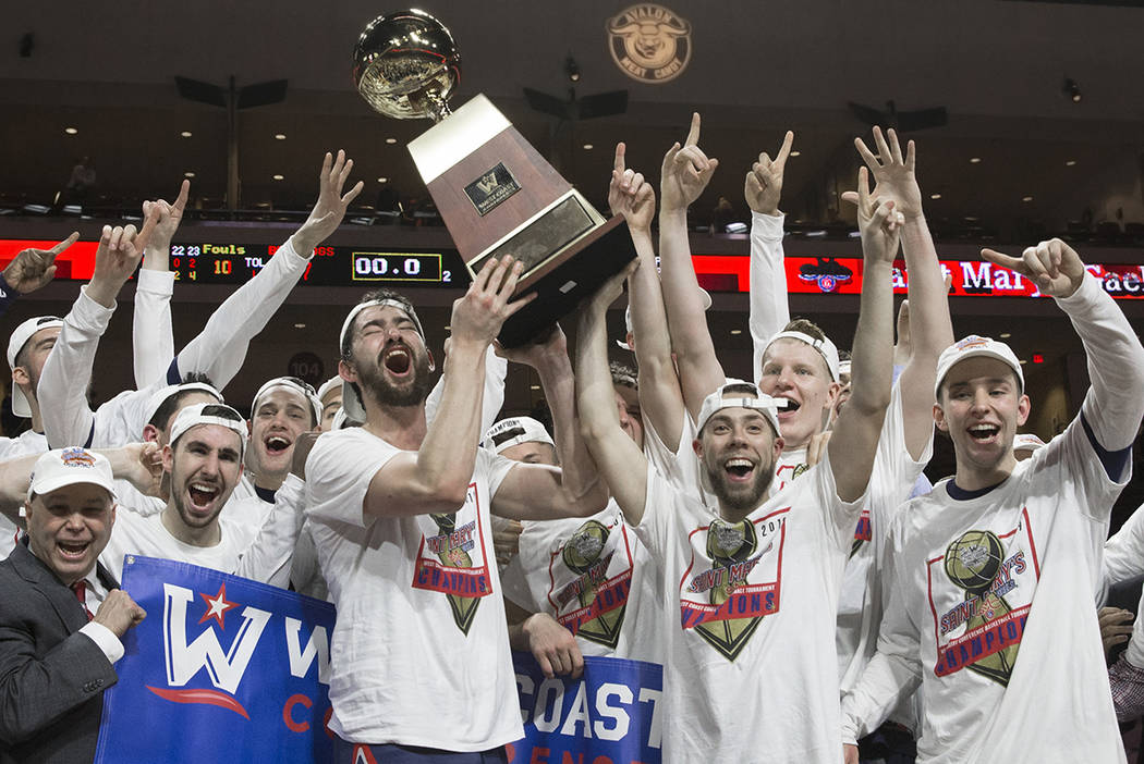 Saint Mary'shoists the trophy after upsetting Gonzaga 60-47 to win the West Coast Confere ...