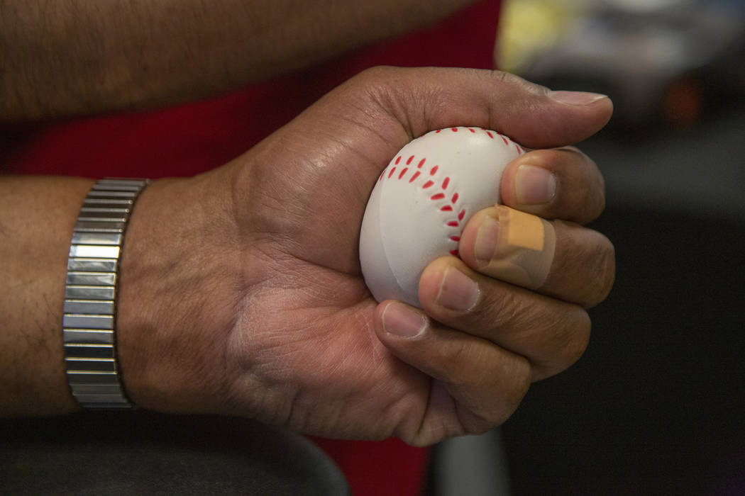 James Clark, 63, holds a pressure ball during the American Red Cross blood drive at Findlay Hon ...
