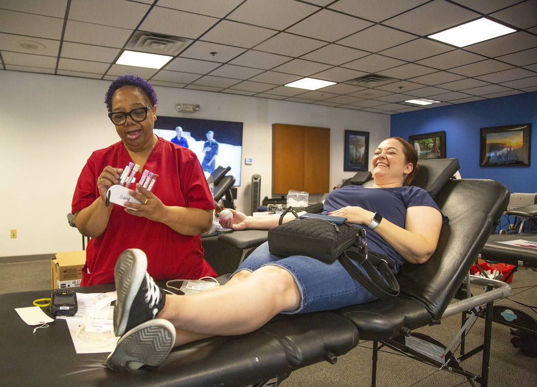 Barbara Moor, 57, prepares to draw blood from Audra Findley, during the American Red Cross bloo ...