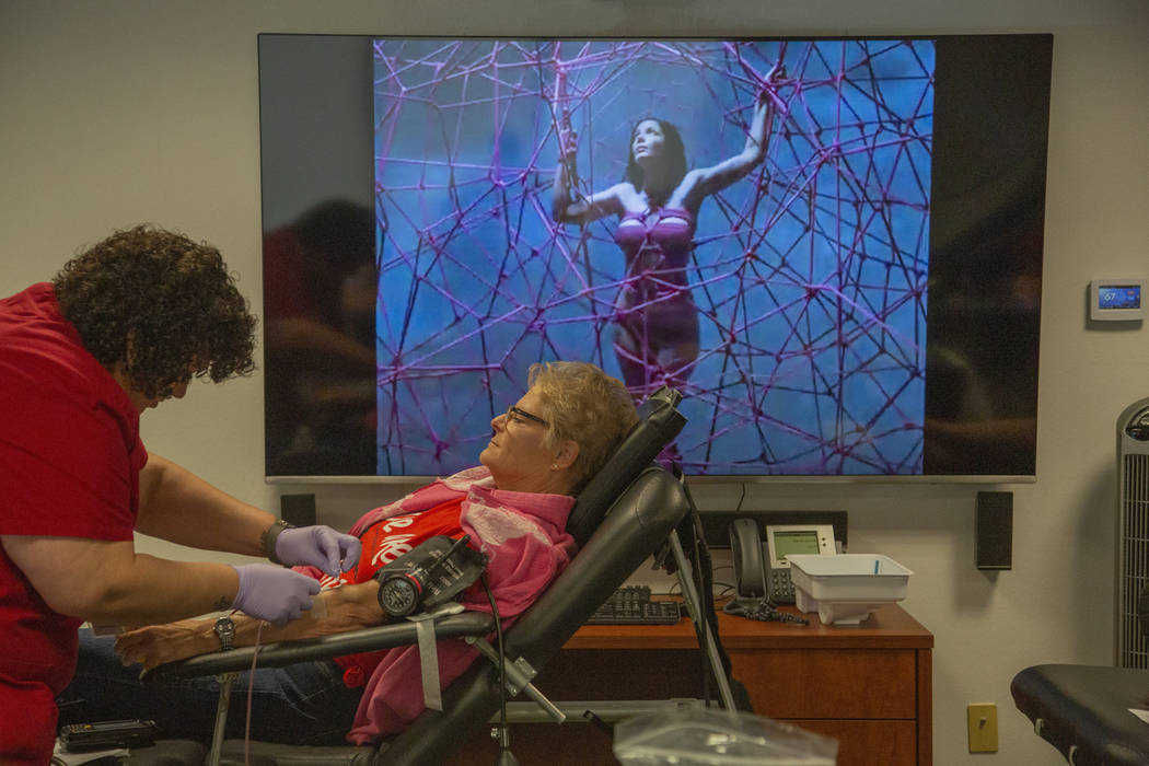 Marya Lebeau, 58, draws blood from Misty Jones, 30, from Toquerville, Utah, during the American ...