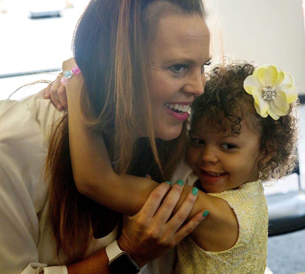 Layla O'Bryant, 4, who needs blood transfusions, hugs her mom Molly O'Bryant during the America ...