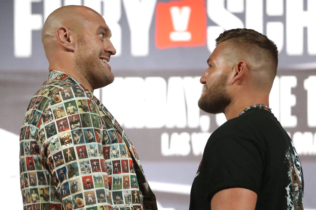Tyson Fury, left, and Tom Schwarz, pose during their boxing press conference at the MGM Grand h ...