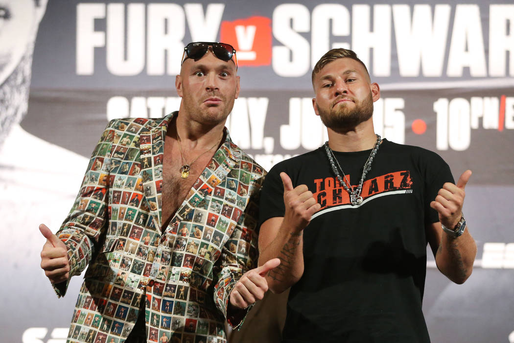 Tyson Fury, left, and Tom Schwarz pose during their boxing press conference at the MGM Grand ho ...