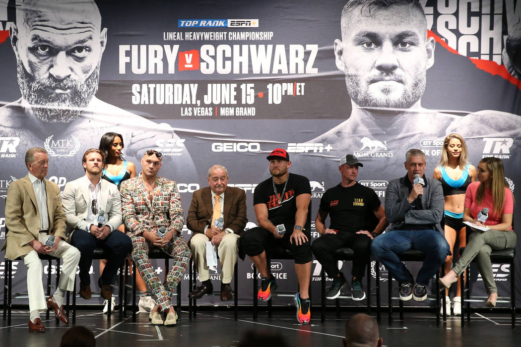 Fighters and promoters participate during the final press conference for the upcoming heavyweig ...