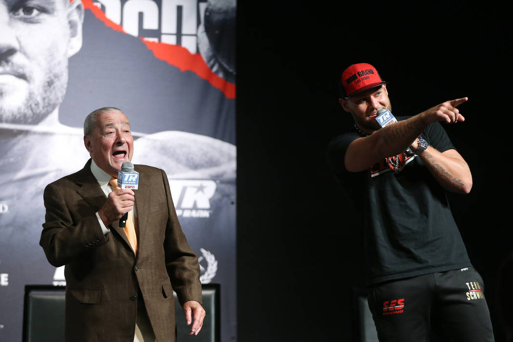 Boxing promoter Bob Arum, left, and boxer Tom Schwarz during a press conference for his upcomin ...