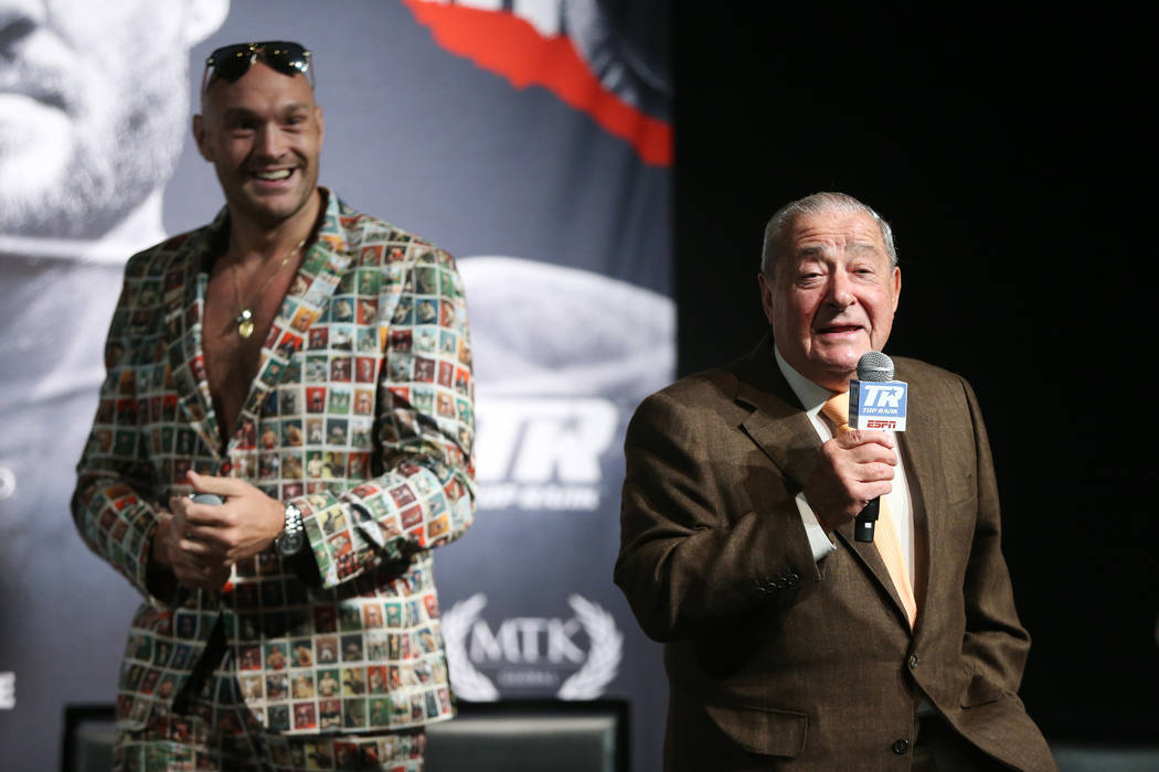 Boxer Tyson Fury, left, with promoter Bob Arum, during a press conference for his upcoming boxi ...