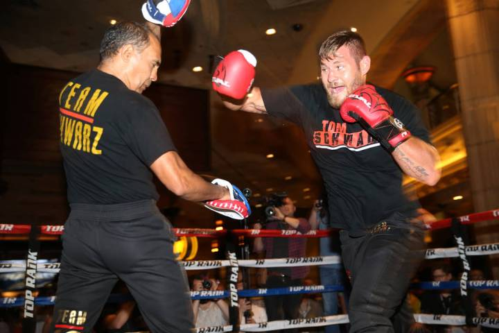 Tom Schwarz, right, throws a punch during an open workout event at the MGM Grand hotel-casino i ...