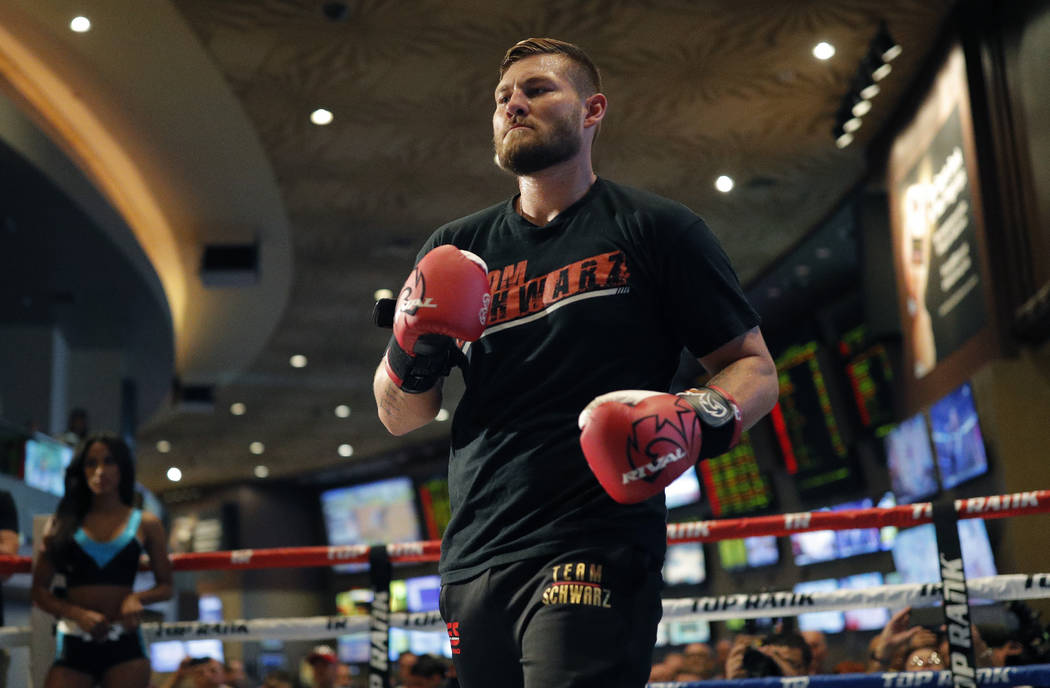 Tom Schwarz, of Germany, works out for fans and the media Tuesday, June 11, 2019, in Las Vegas. ...