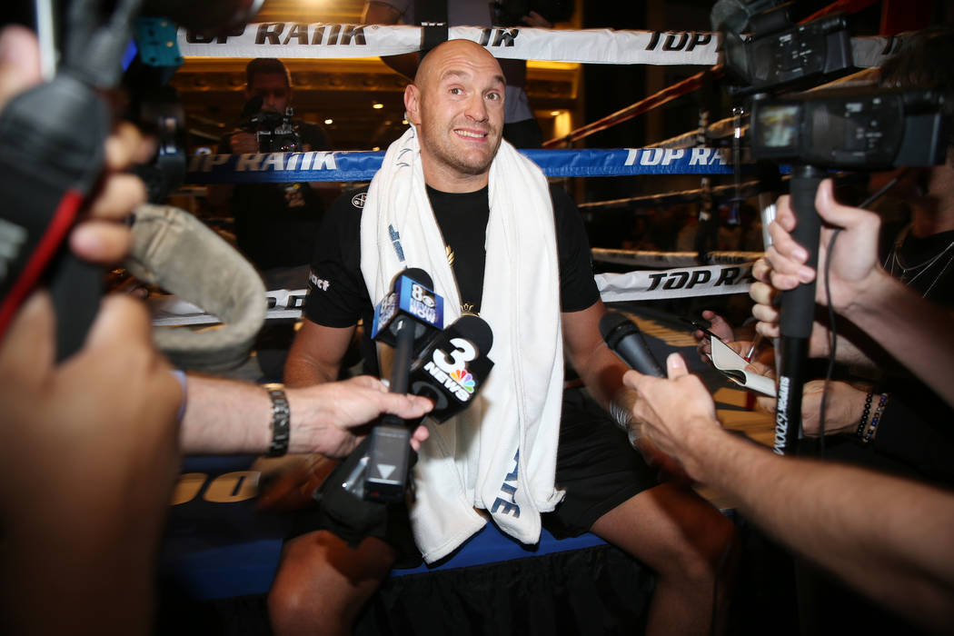 Tyson Fury is interviewed following an open workout event at the MGM Grand hotel-casino in Las ...