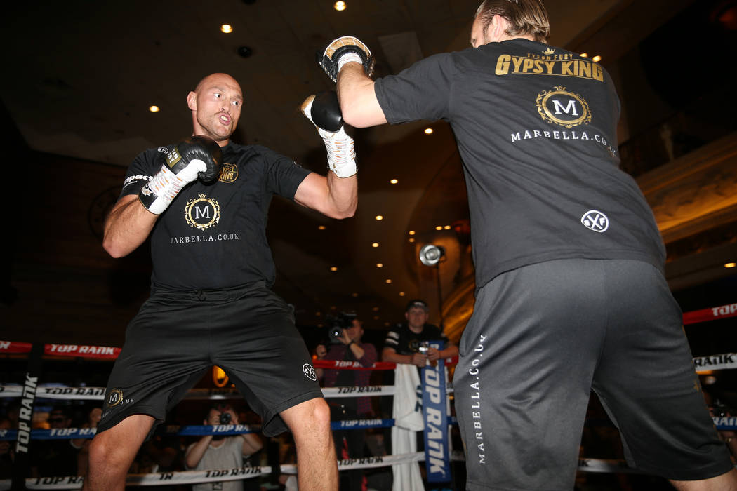 Tyson Fury, left, throws a punch during an open workout event at the MGM Grand hotel-casino in ...