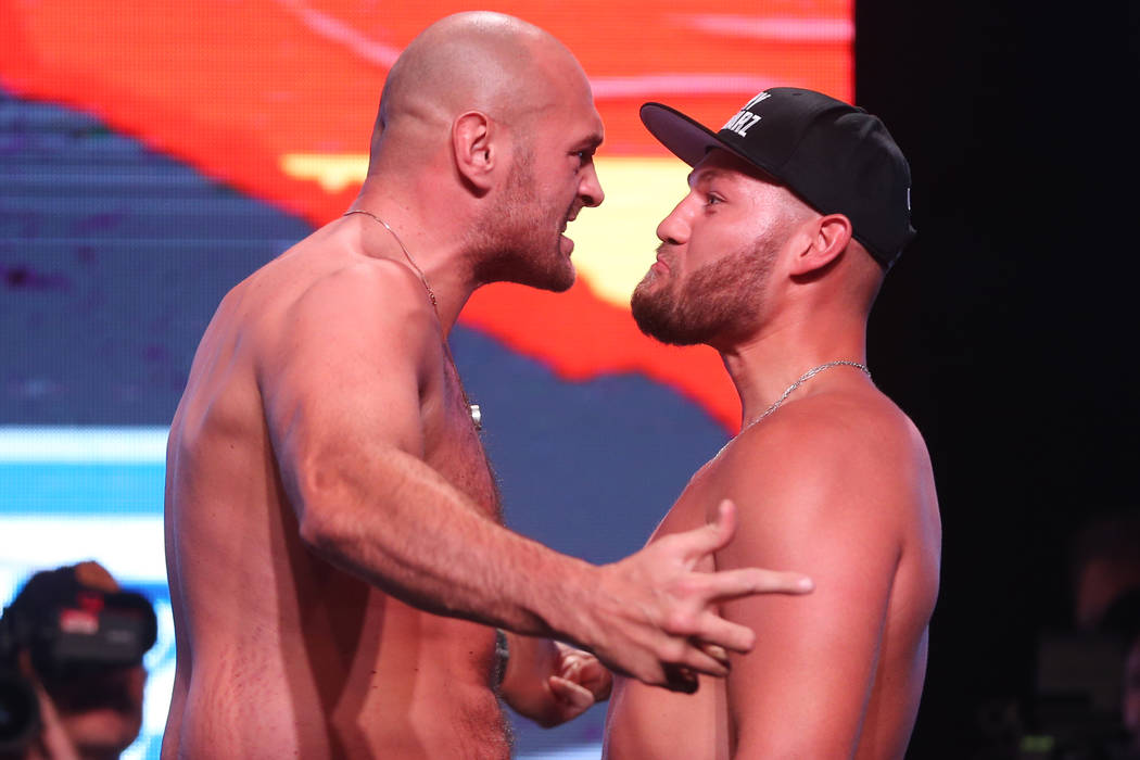 Tyson Fury, left, and Tom Schwarz, pose during their weigh-in event at the MGM Grand Garden Are ...