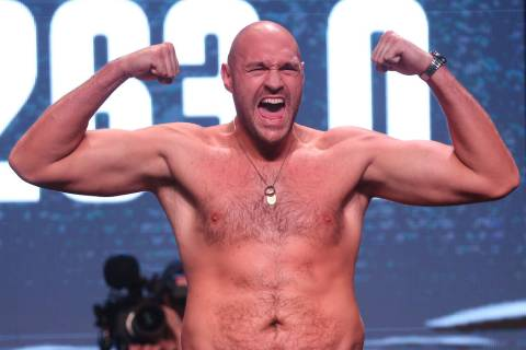 Tyson Fury poses during his weigh-in event at the MGM Grand Garden Arena in Las Vegas, Friday, ...