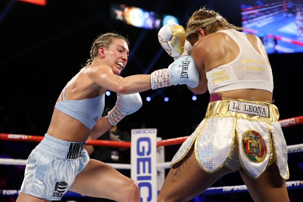 Mikaela Mayer, left, throws a punch against Lizbeth Crespo in the womenÕs super featherwei ...