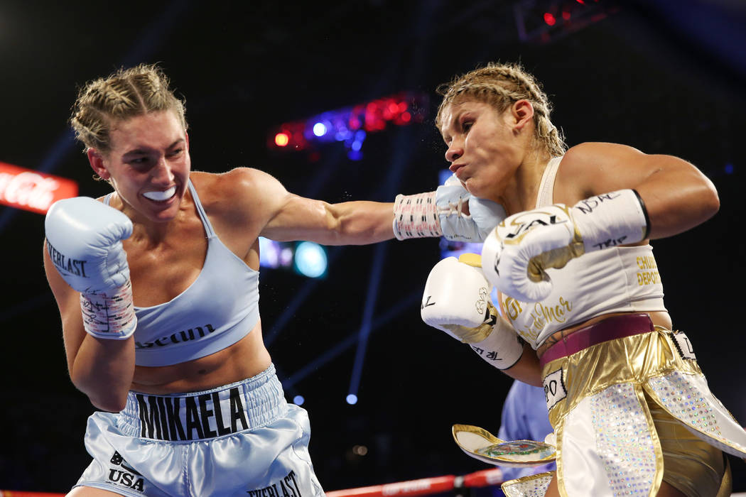 Mikaela Mayer, left, connects a punch against Lizbeth Crespo in the womenÕs super featherw ...
