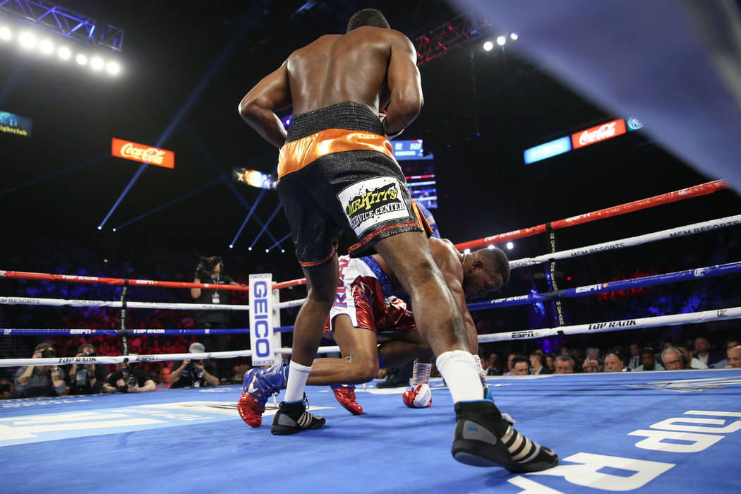 Jesse Hart, left, knocks down Sullivan Barrera in the light heavyweight bout at the MGM Grand G ...