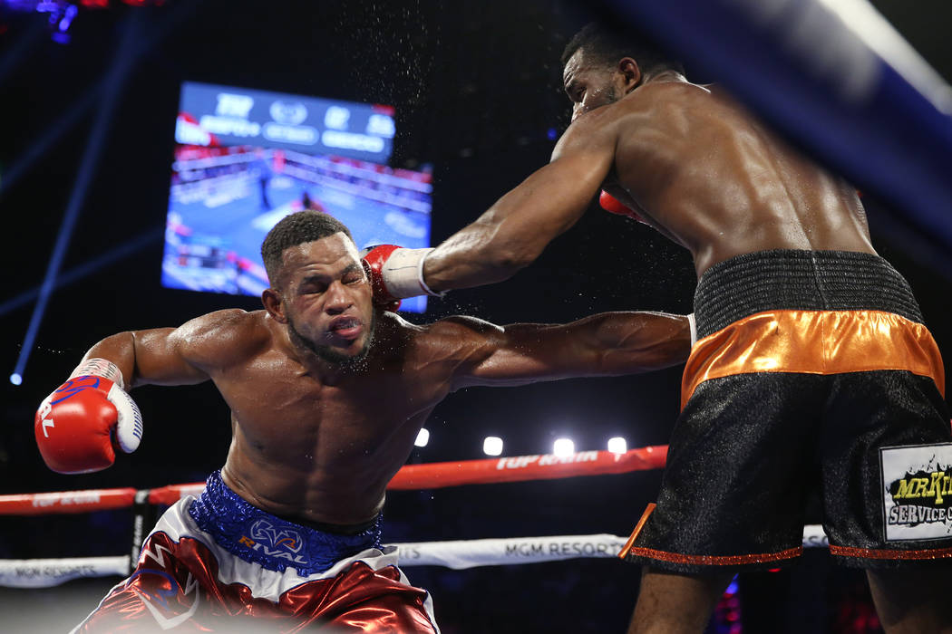 Jesse Hart, right, connects a punch against Sullivan Barrera in the light heavyweight bout at t ...