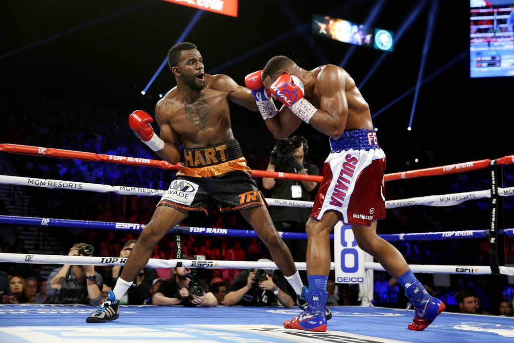 Jesse Hart, right, battles Sullivan Barrera in the light heavyweight bout at the MGM Grand Gard ...