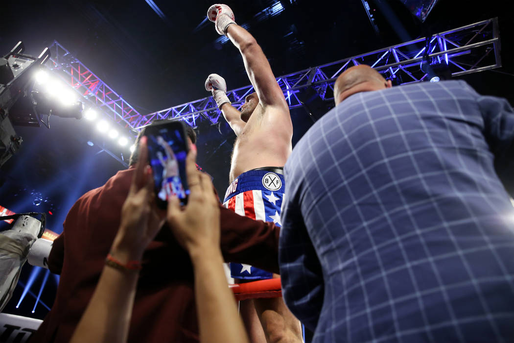 Tyson Fury celebrates his win against Tom Schwarz in the lineal heavyweight bout at the MGM Gra ...