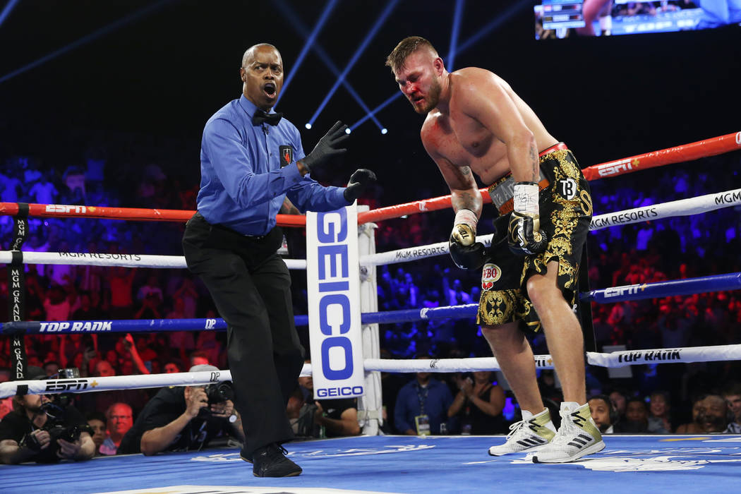 Tom Schwarz, right, gets a count after getting knocked down by Tyson Fury in the second round o ...