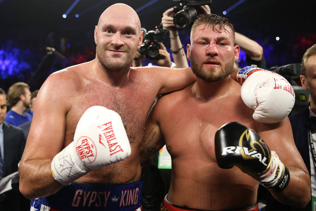 Tyson Fury, left, and Tom Schwarz pose after their fight in the lineal heavyweight bout at the ...