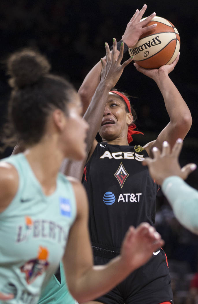 Las Vegas Aces center A'ja Wilson (22) slashes to the rim in traffic in the first quarter durin ...