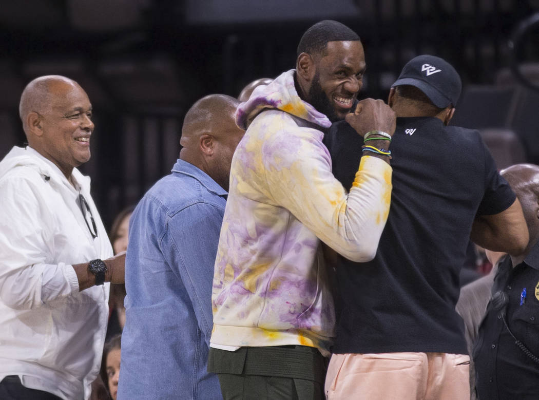 Los Angeles Lakers power forward LeBron James, second from left, greets Oklahoma City Thunder p ...