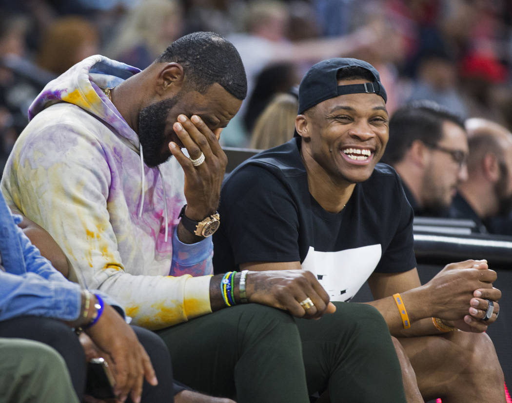 Oklahoma City Thunder point guard Russell Westbrook, right, shares a laugh with Los Angeles Lak ...