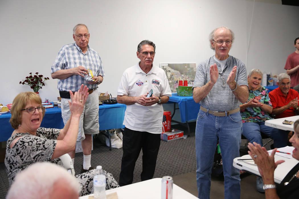 North Las Vegas Ward 4 incumbent councilman Richard Cherchio, center, celebrates early election ...