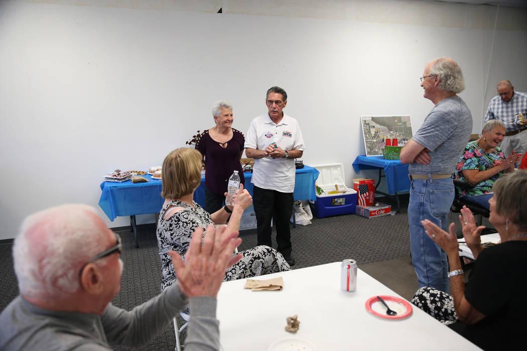 North Las Vegas Ward 4 incumbent councilman Richard Cherchio, center, with his wife Gloria, lef ...