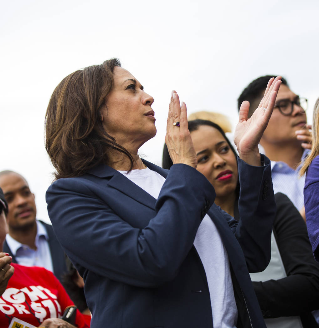 U.S. Sen. Kamala Harris, D-Calif., a Democratic presidential hopeful, claps while listening to ...