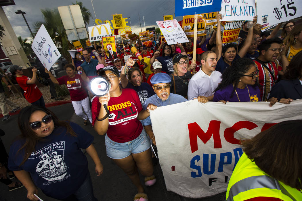 Workers march in support of high minimum wage outside of McDonald's in Las Vegas on Friday, Jun ...