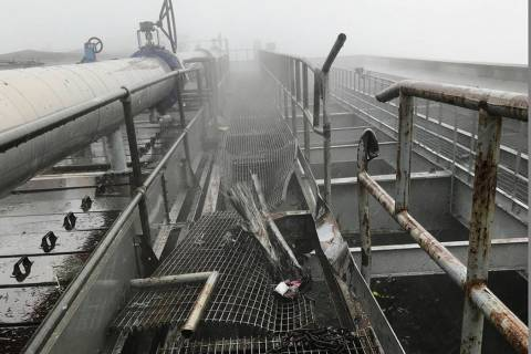 This photo released by the New York City Fire Department shows damage caused by a helicopter cr ...