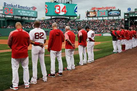 The Boston Red Sox and fans pause for a moment for former Red Sox designated hitter David Ortiz ...