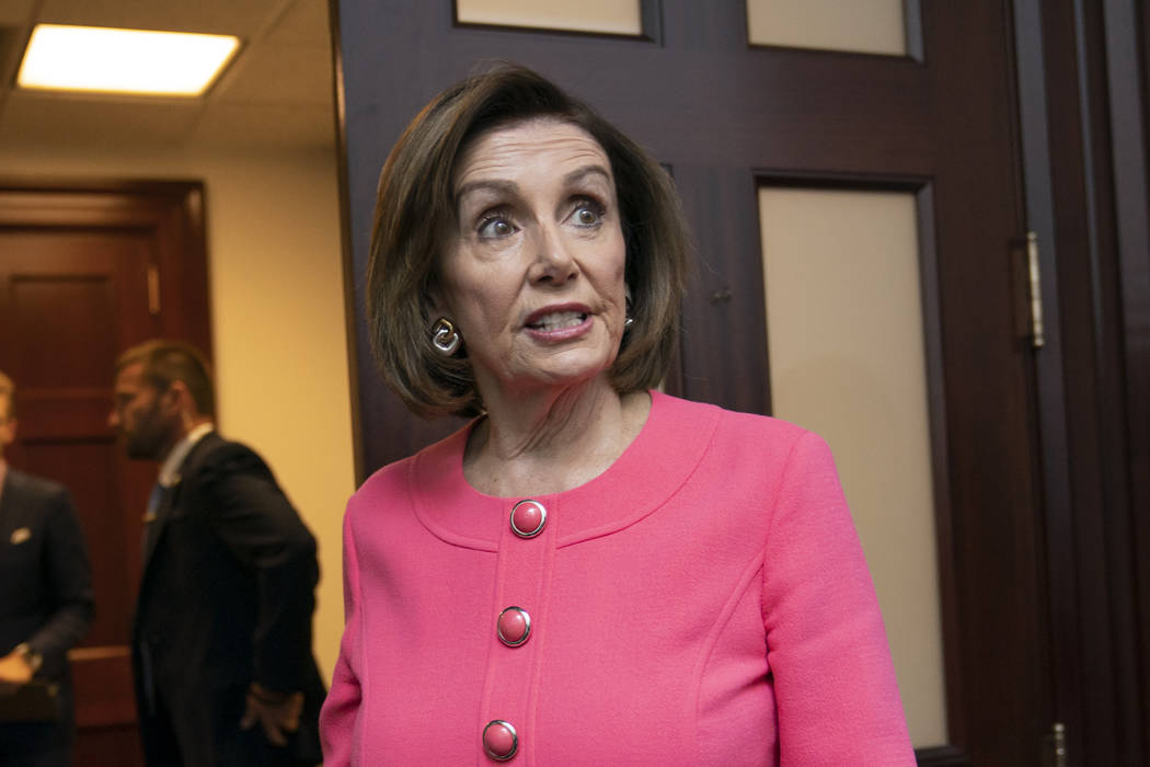 Speaker of the House Nancy Pelosi, D-Calif., arrives for a closed-door meeting with her Democra ...