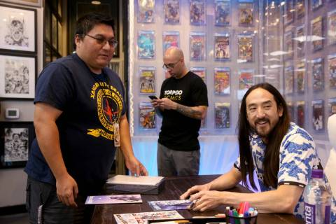 DJ Steve Aoki, right, visits with Larry Nakauchi of Las Vegas during a signing for his new comi ...