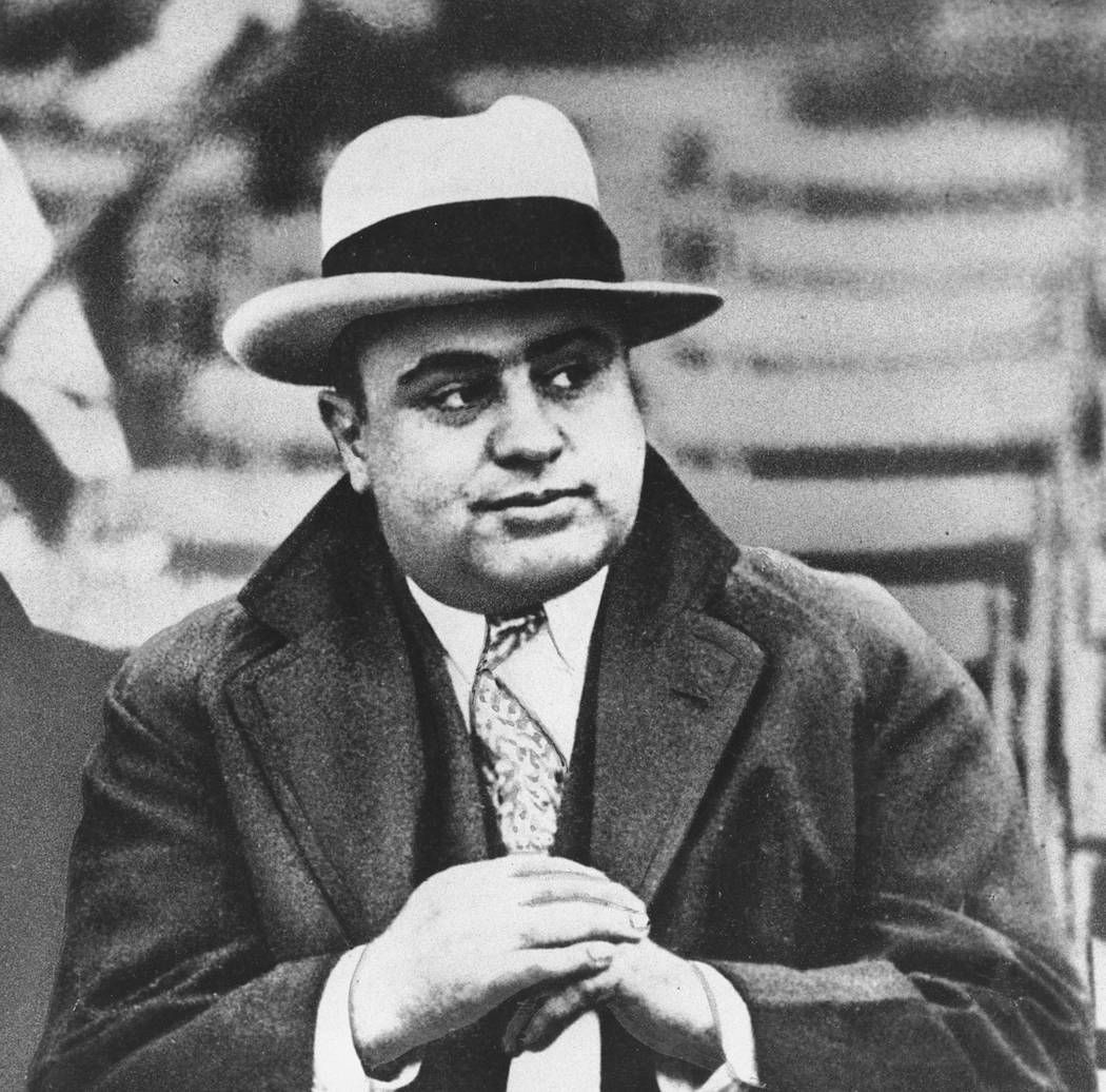 In this Jan. 19, 1931 file photo, Chicago mobster Al Capone is seen at a football game in Chica ...