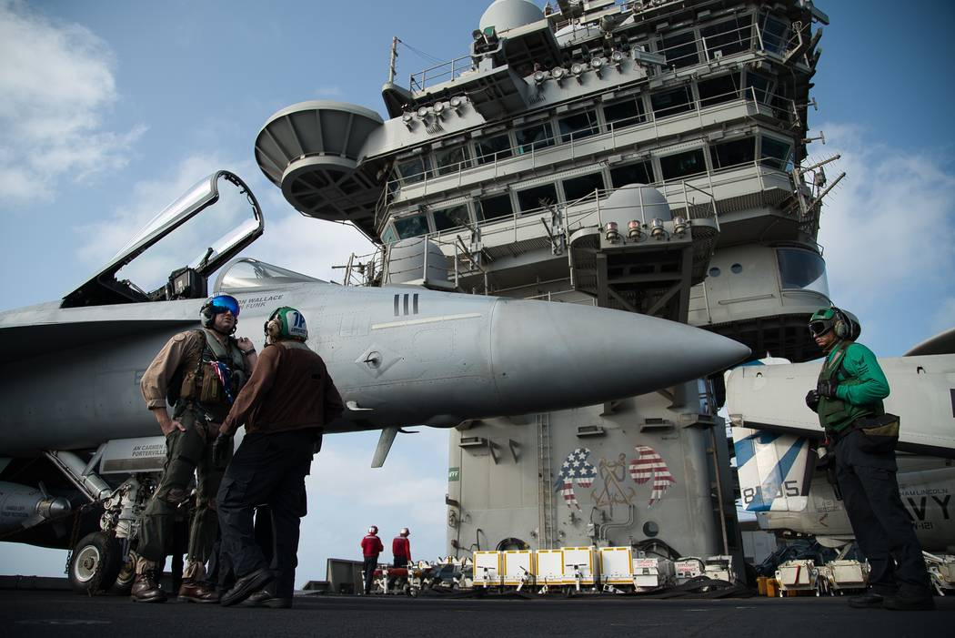 FILE - In this June 3, 2019 file photo, a pilot speaks to a crew member by an F/A-18 fighter je ...