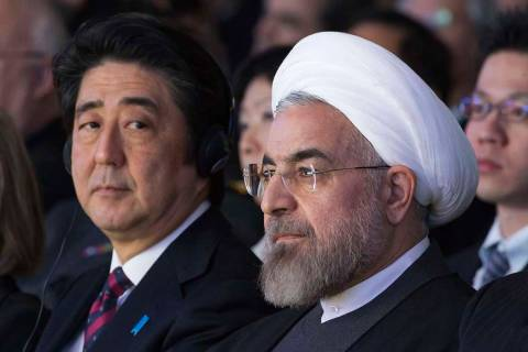 FILE - In this Jan. 22, 2014 file photo, Japanese Prime Minister Shinzo Abe, left, and Iranian ...