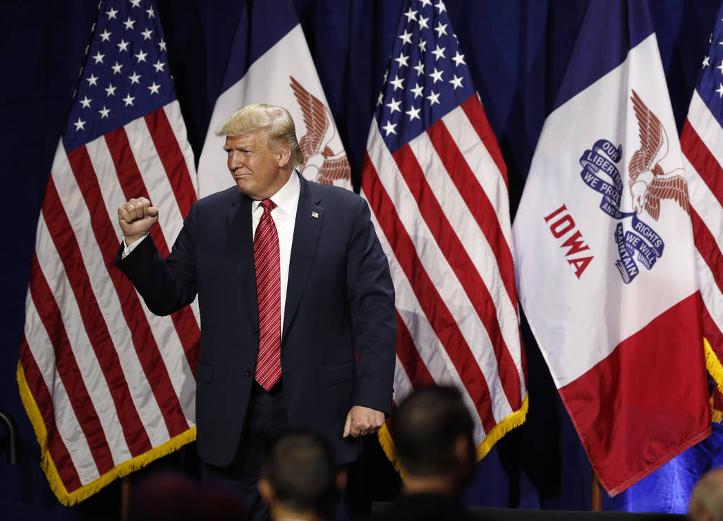 President Donald Trump acknowledges supporters after speaking at the Republican Party of Iowa's ...